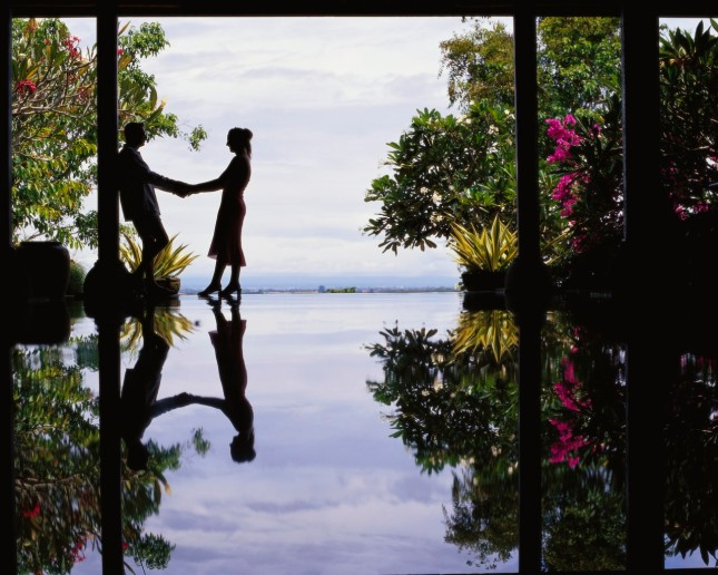 Water Reflecting Silhouette of Couple